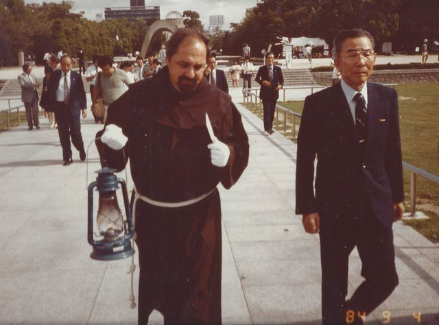 Father Lombardi carries the flame from the Hiroshima Peace Memorial with Mayor Takeshi Araki
