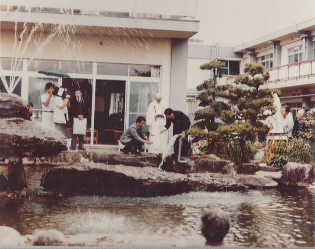The Mayor of Nagasaki collects the water for the Toronto Peace Garden